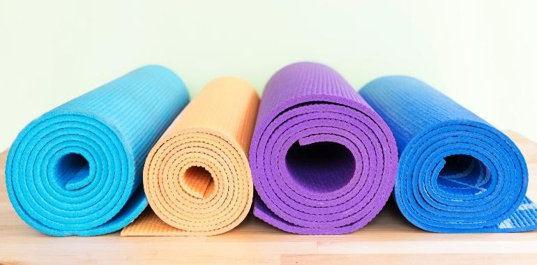 Colorful rolled up yoga mats